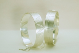 Hinged bracelets - silver, roll-printed